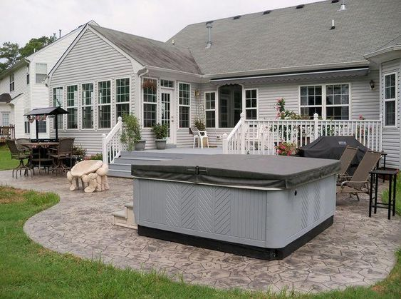 Stamped concrete patio with hot tub