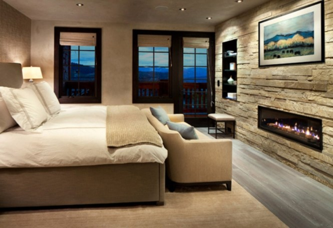 Bedroom With Stone Wall And Fireplace